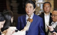 Japan's PM says he won't force sales tax hike if shock hits economy